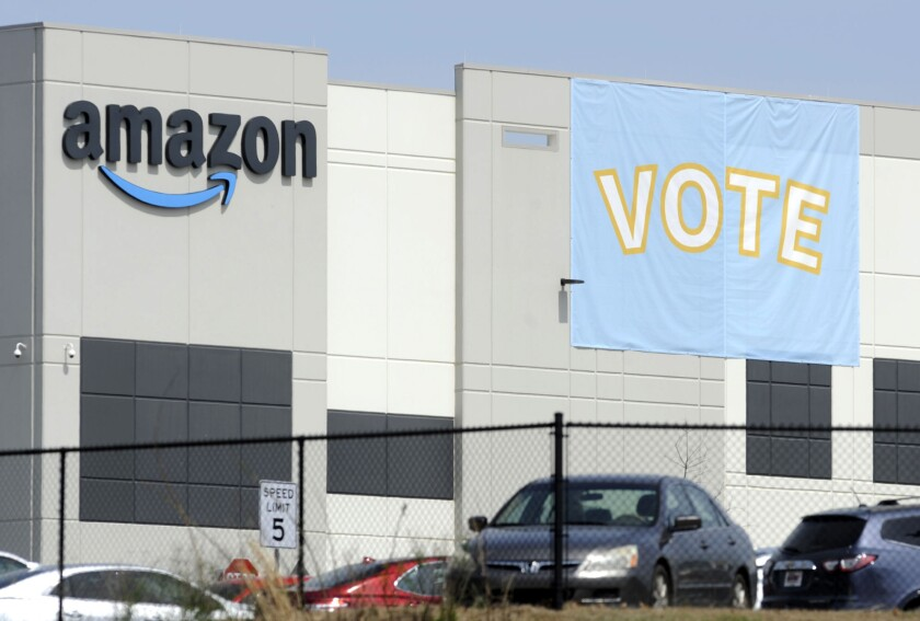 FILE - In this Tuesday, March 30, 2021 file photo, A banner encouraging workers to vote in labor balloting is shown at an Amazon warehouse in Bessemer, Ala. Nearly 6,000 Amazon warehouse workers in Bessemer, Alabama, have voted on whether or not to form a union. But the process to tally all the ballots and determine an outcome will continue for a second week, according to the National Labor Relations Board, a government agency that's conducting the election. (AP Photo/Jay Reeves, File)
