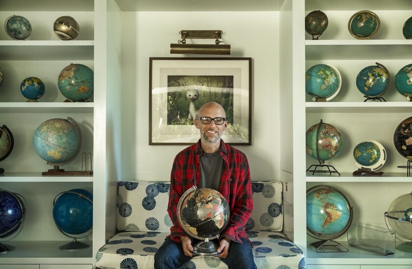 "Moby holds his first globe, which he purchased as a child shopping with his mother at a thrift store. He collects vintage globes that show country place names that have disappeared into history, such as Rhodesia and Indochina. ""It's an object lesson in impermanence,"" he says."