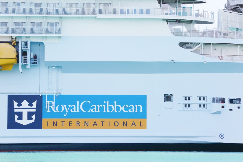 FILE - In this March 14, 2020 file photo, Royal Caribbean International cruise ship docked at PortMiami in Miami. Six passengers from a Royal Caribbean cruise have tested positive after the ship docked in the Bahamas. Royal Caribbean said Friday, July 30, 2021, that four of them are adults who were all vaccinated against COVID-19, and two are minors who were not vaccinated. (AP Photo/Brynn Anderson, File)