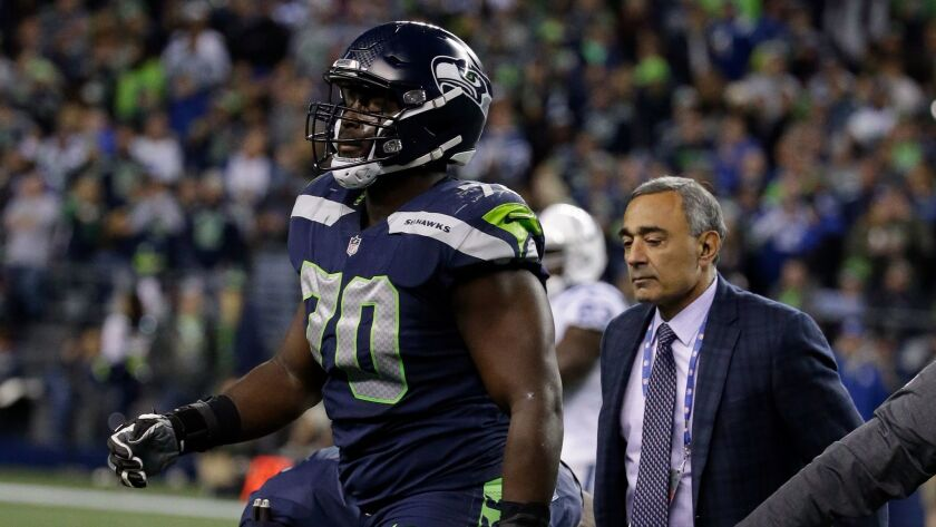 Seattle Seahawks offensive tackle Rees Odhiambo leaves the field with an injury in the second half of a game against the Indianapolis Colts.