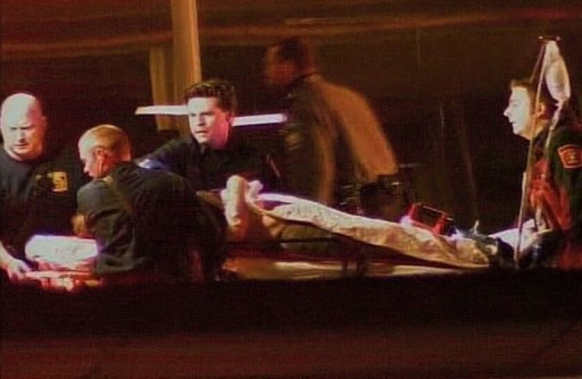 In this image from video provided by WJLA-TV, a person on a stretcher is loaded into an ambulance outside the Pentagon Metro Station Thursday, March 4, 2010, in Washington. A gunman opened fire at the subway entrance to Pentagon complex Thursday evening, wounding two Pentagon police officers, a spokesman said. (AP Photo/WJLA-TV) MANDATORY CREDIT, NO SALES