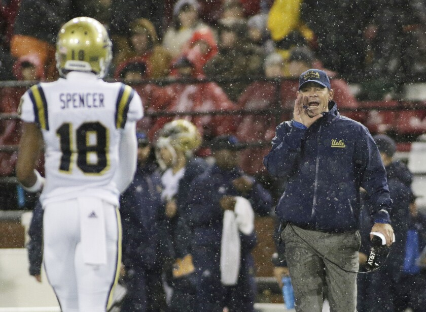 UCLA Coach Jim Mora directs his team during the first half of a game against Washington State on Oct. 15.