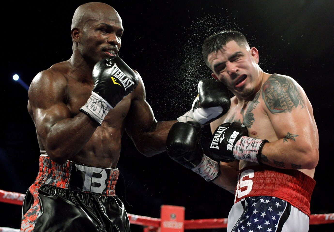 Champion Timothy Bradley (L) connects with a left against challenger Brandon Rios (R) at the Thomas & Mack Center in Las Vegas, Nevada. Bradley retained his welterweight title by technical knockout at 2:49 of the ninth round.