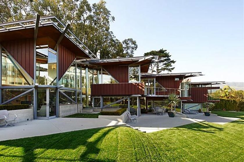 A steel-and-glass three-story was designed by architect Bart Prince.