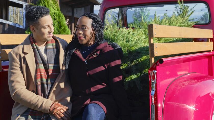 "Antonio Cayonne and Rukiya Bernard in ""Christmas in Evergreen: Bells Are Ringing"" on Hallmark."