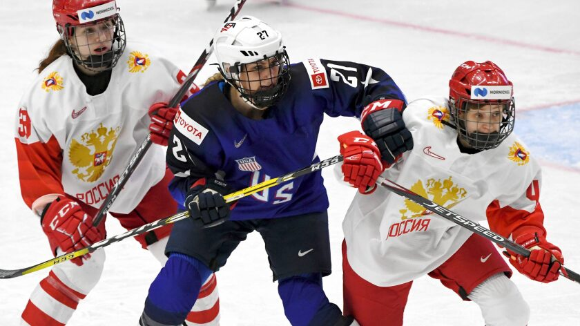 Team USA's Hilary Knight, center, battles Russia's Daria Teryoshkina, left, and Oxana Bratisheva during the 2019 IIHF women's hockey world championships semifinals.