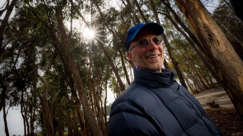 "Composer John Luther Adams under the eucalyptus canopy of ""The Wind Garden"" at UC San Diego."