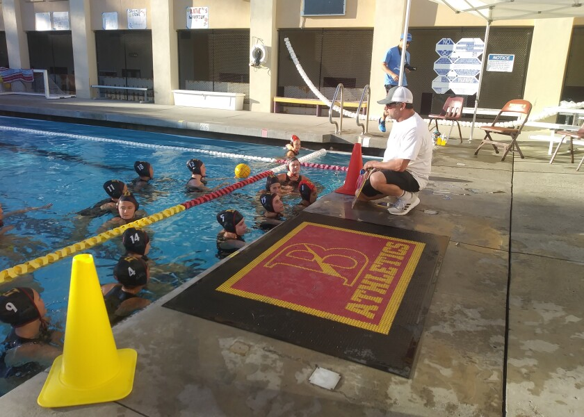 Bishop's coach Doug Peabody instructs the Knights ahead of their 17-2 victory over Del Norte for the San Diego Open girls water polo tournament title in the elite Odin Division on Saturday, Feb. 1.