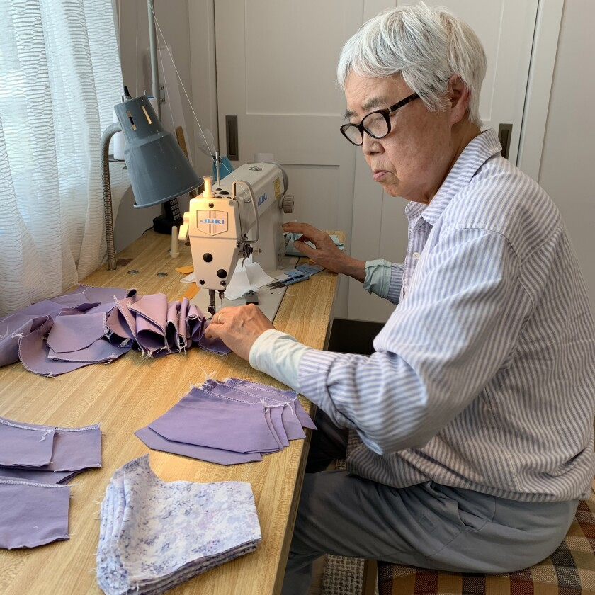Myong Won, 83, sews masks