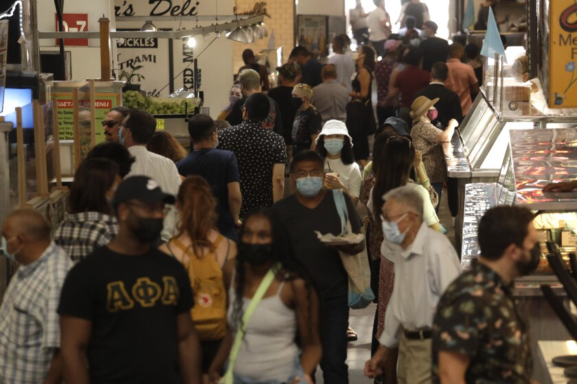 Many people at Grand Central Market in downtown Los Angeles wear masks.
