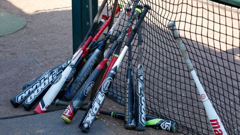 Composite bats at a recent game include the Louisville Slugger TPX Z1000, a 2012 model that's been a hot topic lately.