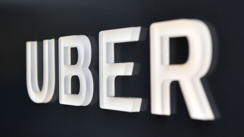 The Uber logo is seen outside the company's headquarters building in San Francisco.