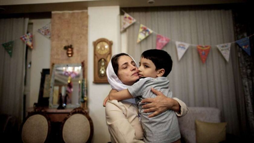 """Iranian lawyer Nasrin Sotoudeh embraces her son Nima upon her release from prison in September 2013 after serving a three-year sentence for """"spreading propaganda against the system."""""""