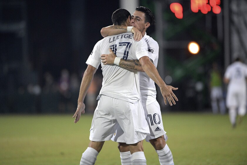 Galaxy forward Cristian Pavon and midfielder Sebastian Lletget celebrate.