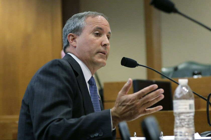 FILE - In this July 29, 2015 file photo, Texas Attorney General Ken Paxton speaks during a hearing in Austin, Texas. Paxton moved June 3, 2016, to muzzle a former state regulator who says he was ordered in 2010 to drop a fraud investigation into Trump University for political reasons. Paxton's offi