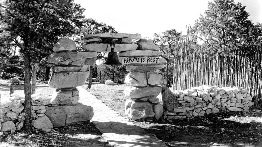 HERMITS REST STONE ENTRANCE ARCH, BELL, WALK AND WALL. NOTE STOCKADE BEHIND AND TO THE RIGHT. 16 NOV