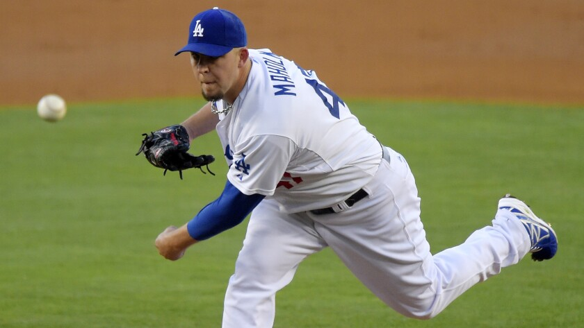 Dodgers starter Paul Maholm delivers a pitch during the team's 1-0 win Saturday over the San Diego Padres at Dodger Stadium.