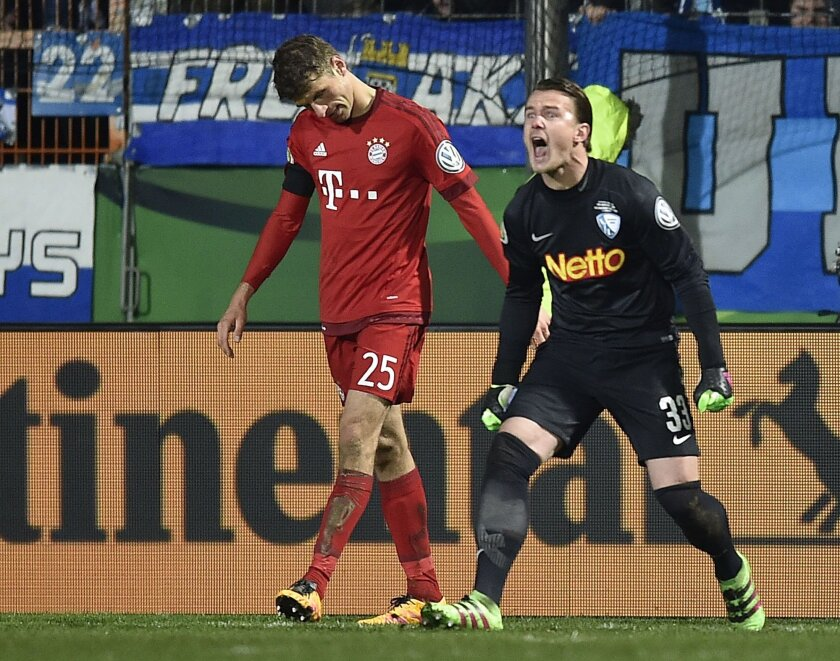 Bochum's keeper Manuel Riemann shouts to Bayern's Thomas Mueller after he catched a penaltyl during the German Soccer Cup quarterfinal match between VfL Bochum and Bayern Munich in Bochum, Germany, Wednesday, Feb. 10, 2016. (AP Photo/Martin Meissner)