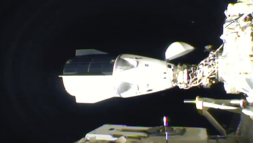 In this frame grab from NASA TV, the SpaceX Dragon is seen after docking at the International Space Station, late Monday.