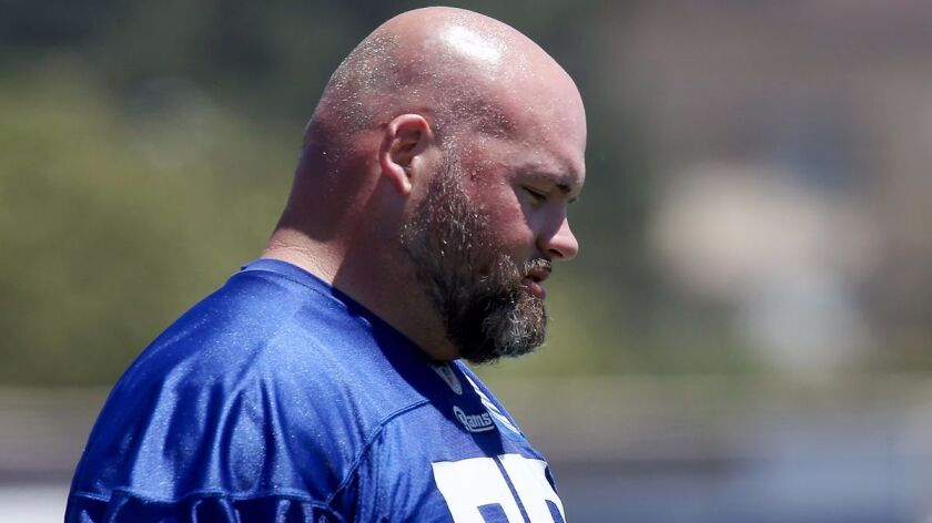 Rams tackle Andrew Whitworth, shown at an organized team activity in 2017, is going to play until he's 45, according to a teammate.