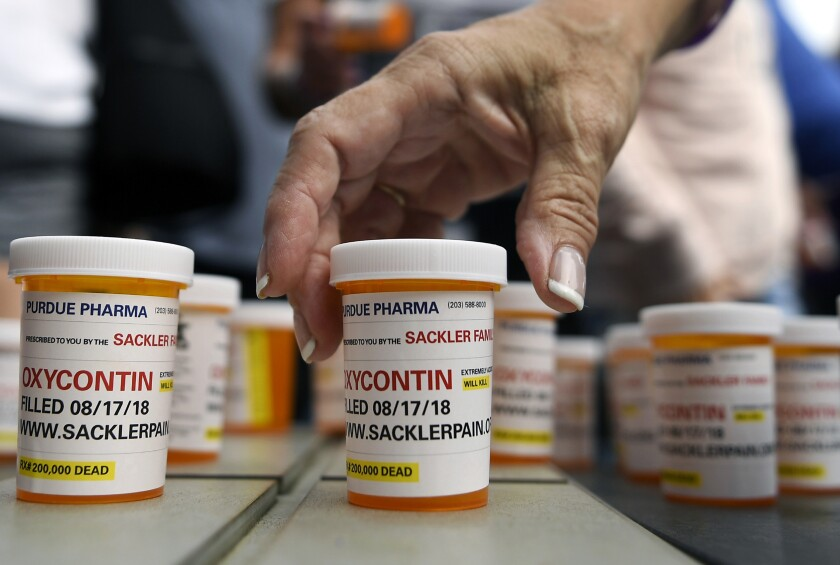 Bottles of OxyContin pills lined up on display