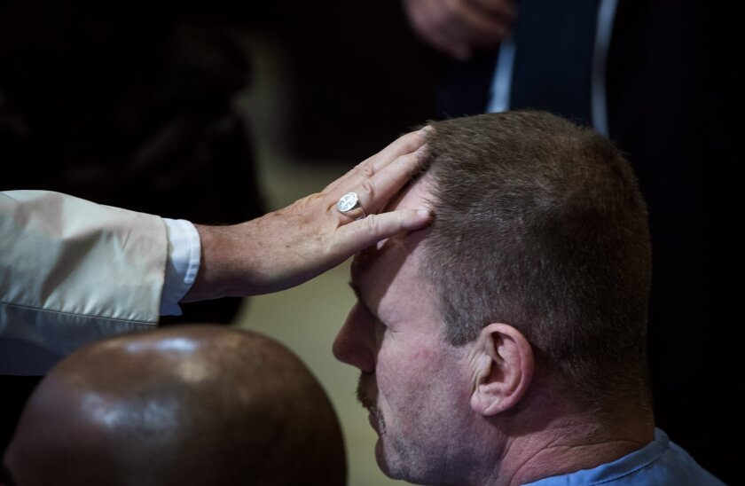 Francis blesses an inmate during his visit to the Curran-Fromhold Correctional Facility in Philadelphia.