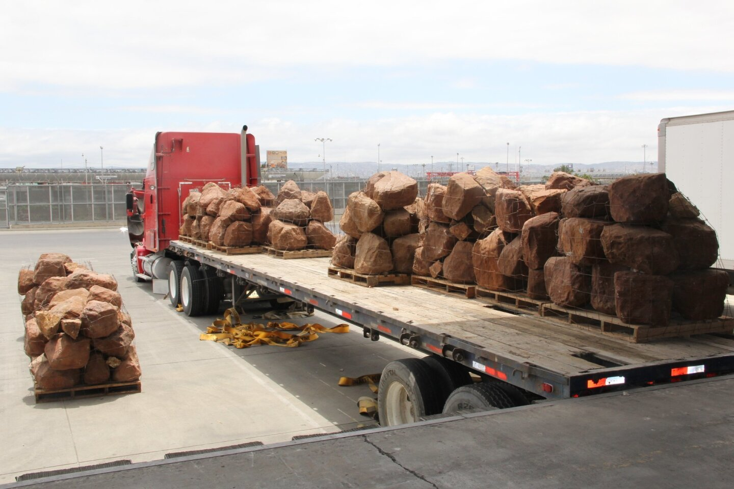 Customs and Border Protection officers seized 577 bundles of marijuana hidden in landscaping stones loaded on a flatbed semi-truck Saturday, authorities said