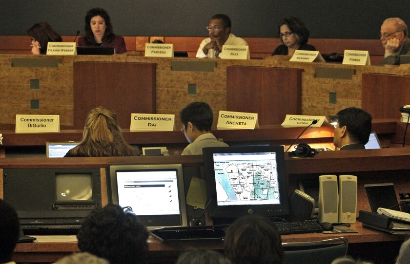 Commissioners in June 2011 listen to public comment at Culver City Hall on a newly drawn congressional redistricting map.