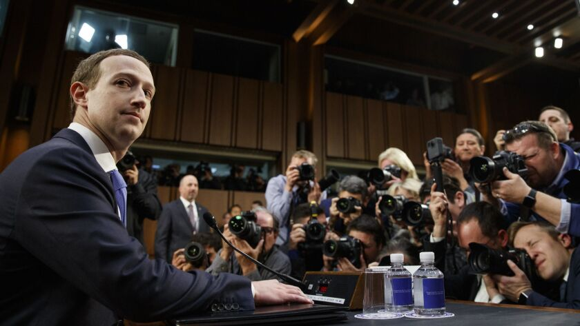 Facebook CEO Mark Zuckerberg prepares to testify before a joint hearing of the Commerce and Judiciary Committees on Capitol Hill in Washington in April about the use of Facebook data to target American voters in the 2016 election.