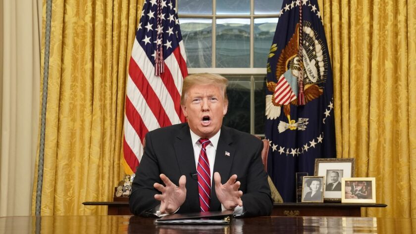 President Donald Trump speaks from the Oval Office of the White House as he gives a prime-time addre