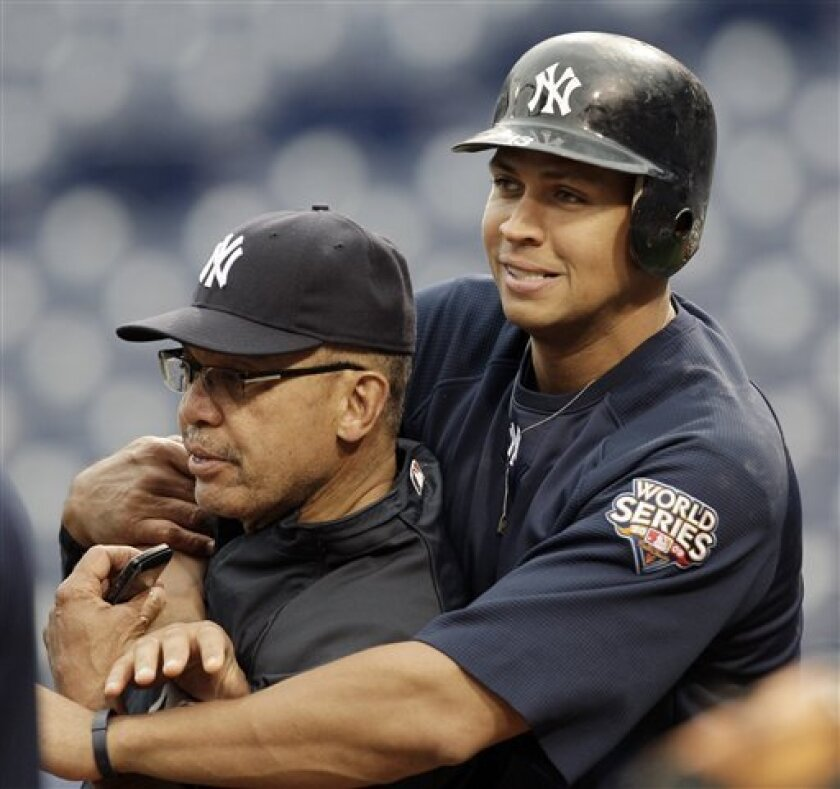 New York Yankees' Alex Rodriguez, right, grabs former Yankee great Reggie Jackson during practice at Citizens Bank Park in Philadelphia Friday, Oct. 30, 2009. The Yankees face the Philadelphia Phillies in Game 3 of the Major League Baseball World Series Saturday night with the series tied 1-1. (AP Photo/Rob Carr)