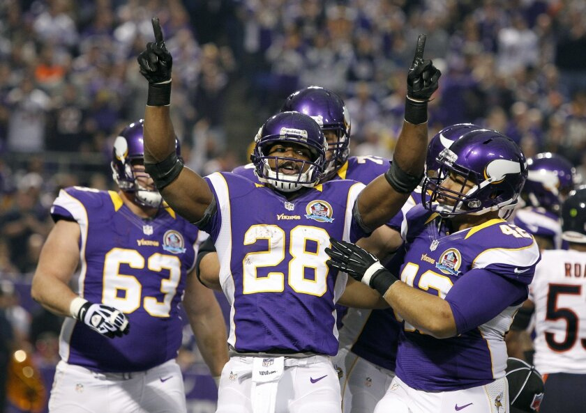 Minnesota Vikings running back Adrian Peterson (28) celebrates after scoring a touchdown in 2012. (AP Photo/Genevieve Ross, File)