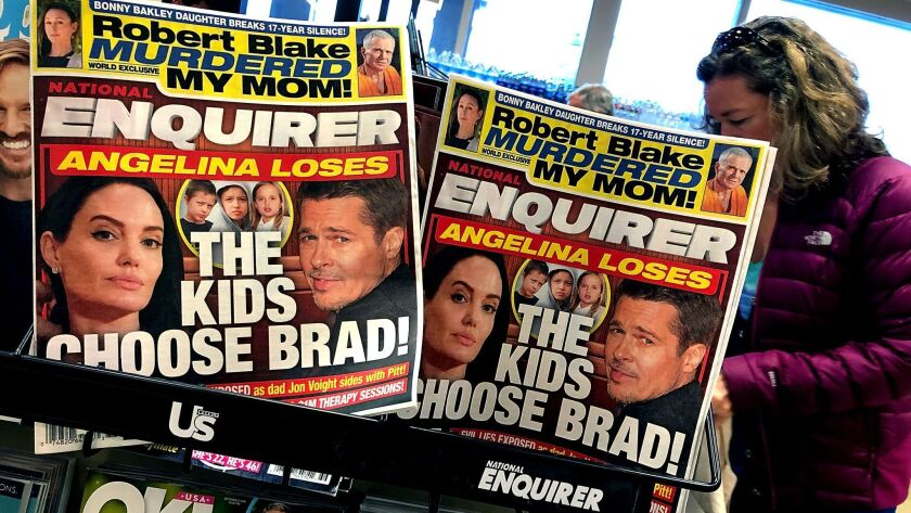 The parent company of the National Enquirer, displayed at a grocery store in San Anselmo, Calif., in 2018, received crucial funding from a hedge fund financed by CalPERS.