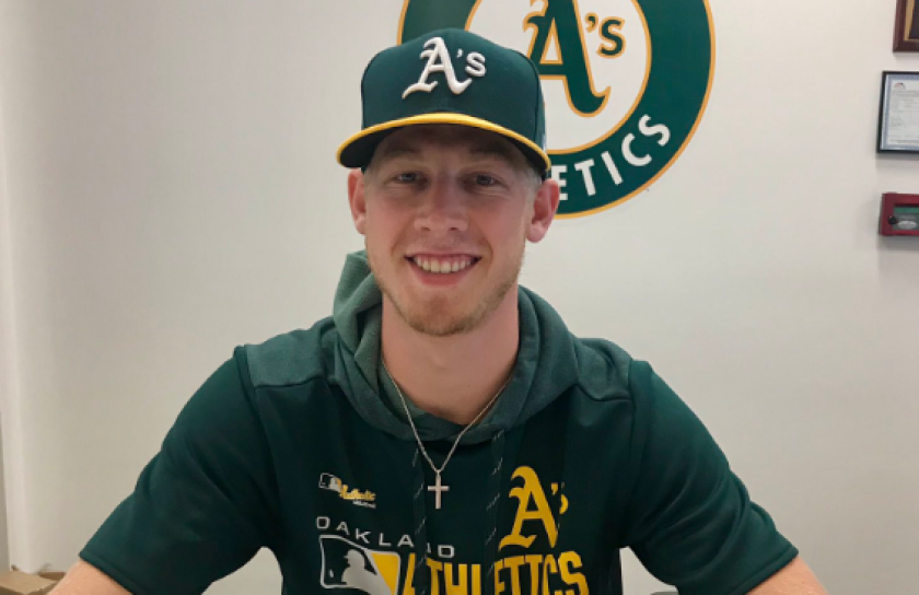 Nathan Patterson smiles after signing a minor-league contract with the Oakland Athletics.