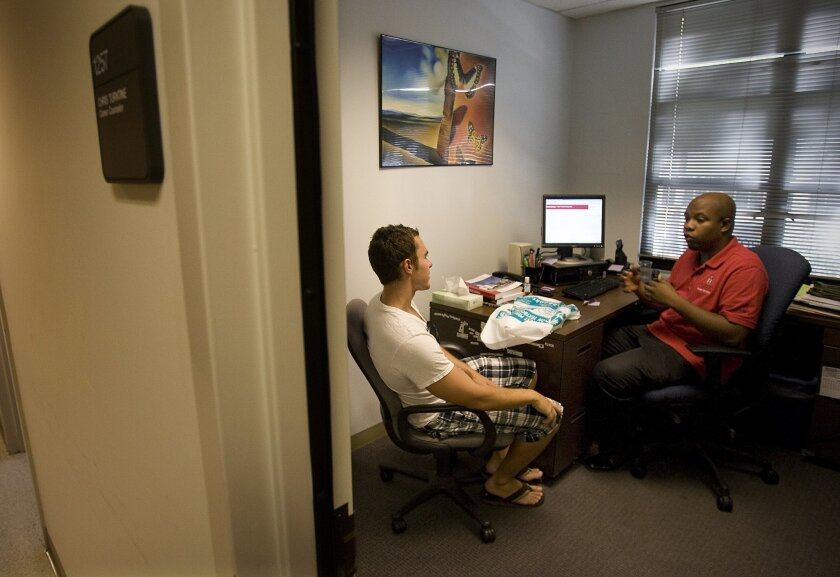 San Diego State career counselor Chris Turntine met with senior student Justin Lang last week.