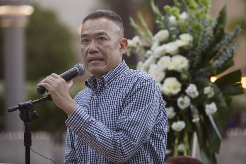 Director of the OC Health Care Agency, Dr. Clayton Chau speaks during a public candlelight memorial on June 11.
