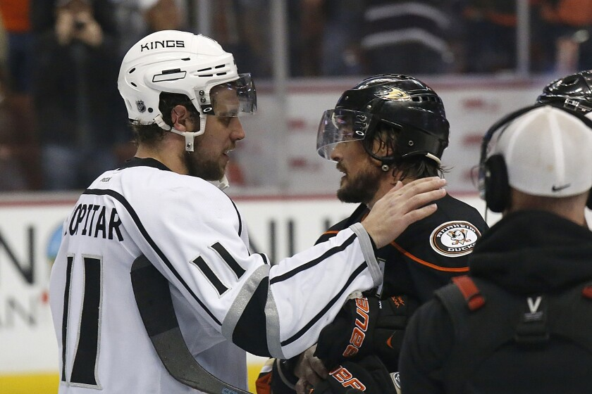 Kings center Anze Kopitar embraces Ducks right wing Teemu Selanne, who played his final NHL game in a 6-2 loss on Friday night at Honda Center in Anaheim. Selanne is retiring at age 43 after 23 seasons.