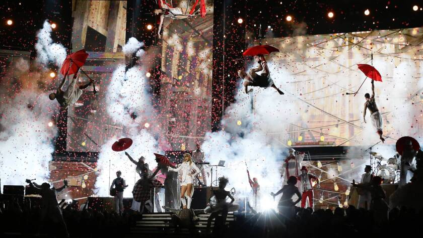 Taylor Swift performs in the opening of the Grammy Awards show.