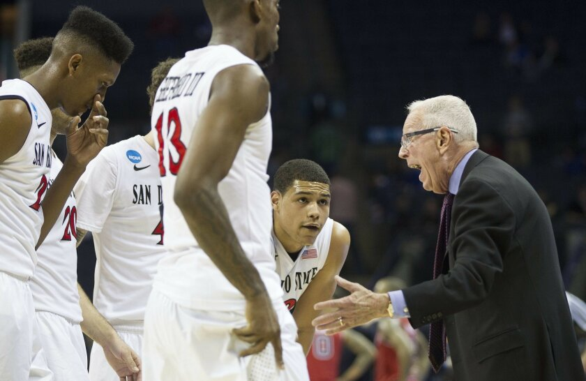 SDSU vs St. John's Mens Basketball in the second round of the NCAA Mens Basketball Tournament. Head Coach Steve Fisher gathers his team in the second half.