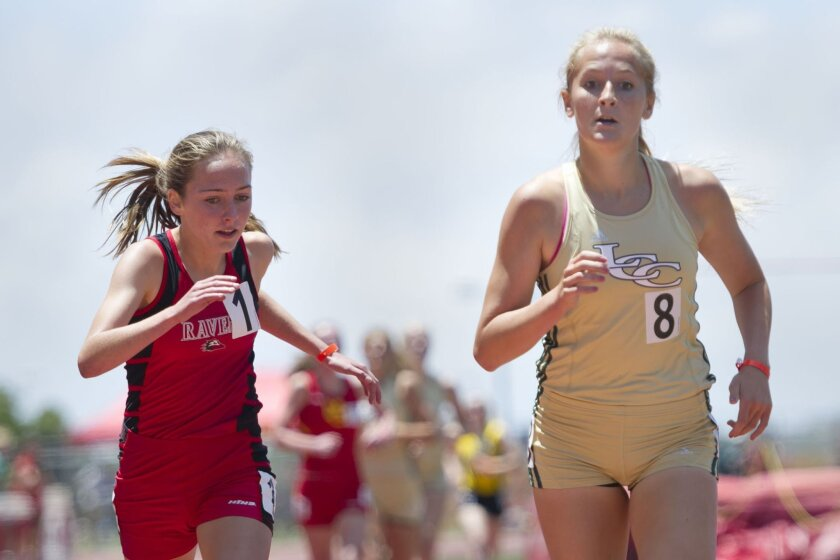 La Costa Canyon's Emma Abrahamson (right) outduels Kelly Bernd of Canyon Crest to win the girls 1,600 meters in 4:54.02 at the San Diego Section championships. Both qualified for state. The Mavericks also won the Division I team title.