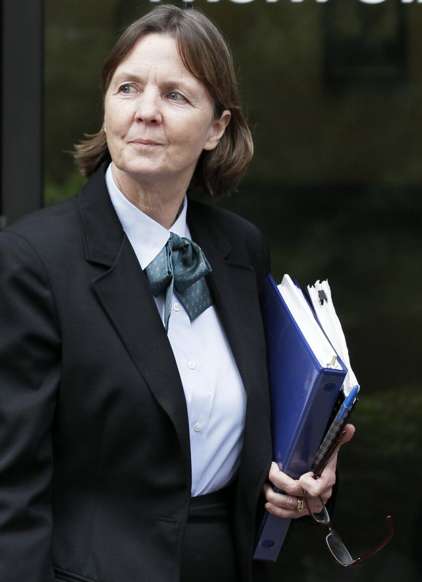 FILE--In this Feb. 18, 2011 file photo, defense attorney Judy Clarke leaves a federal court building in San Diego. (AP Photo/Gregory Bull, File)