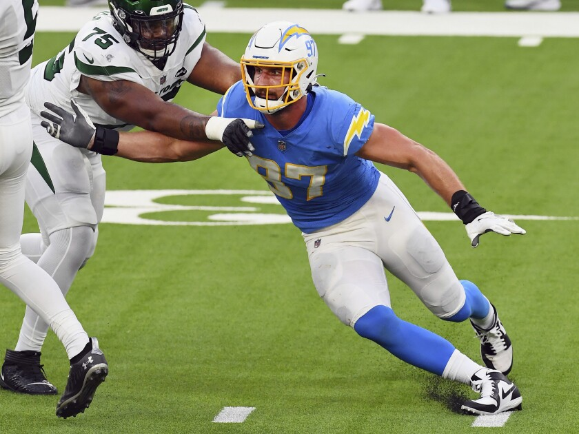 Los Angeles Chargers defensive end Joey Bosa rushes against the Jets' Chuma Edoga in game last month.