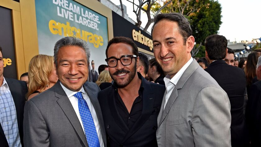 """From left, Warner Bros. Chief Executive Kevin Tsujihara, actor Jeremy Piven and Warner Bros. Pictures President of Creative Development and Worldwide Production Greg Silverman appear at the premiere of """"Entourage."""""""