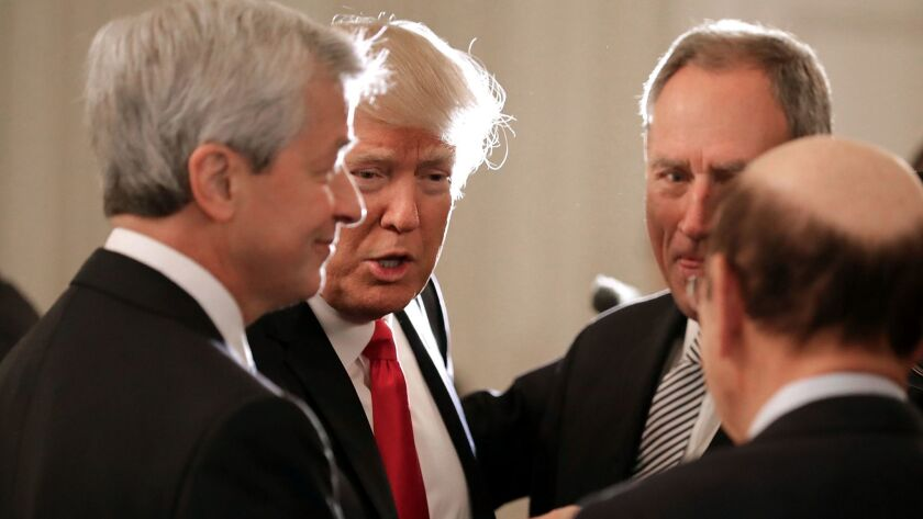 JPMorgan Chase CEO Jamie Dimon, left, powwows with President Trump and other guests during a CEO meeting at the White House in February. The CEO council hasn't met in months.