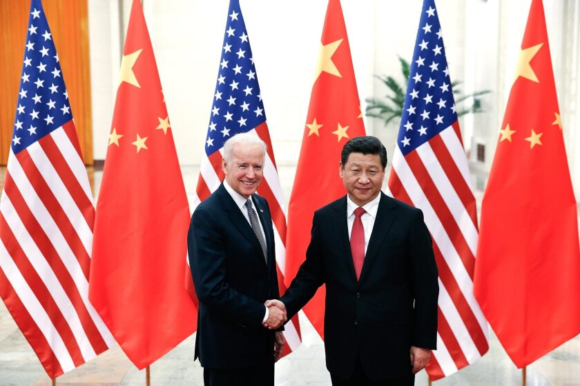 Trump and Biden clash over China in dueling ads