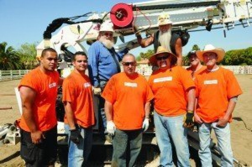 In the front row are Home Depot volunteers Vili Katoango, Dennis Taylor, Jim Winters, JP Torres, Leoni Tiegge and Lou Webb. In the back are SDGE volunteers Dave Holmberg and Pete Petersen. Photo: Jon Clark