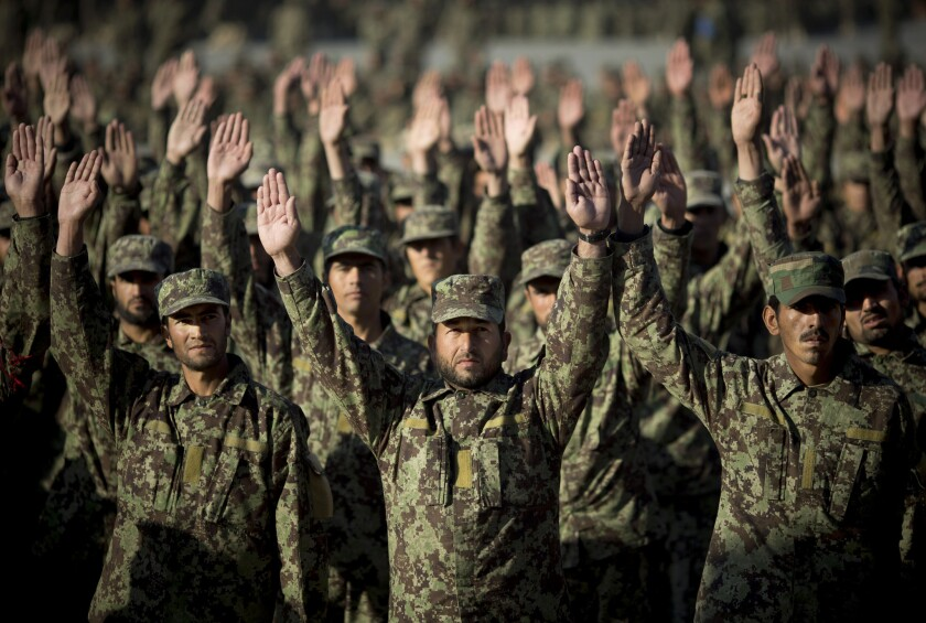 Afghan soldiers participate in morning exercises at a training facility on the outskirts of Kabul.