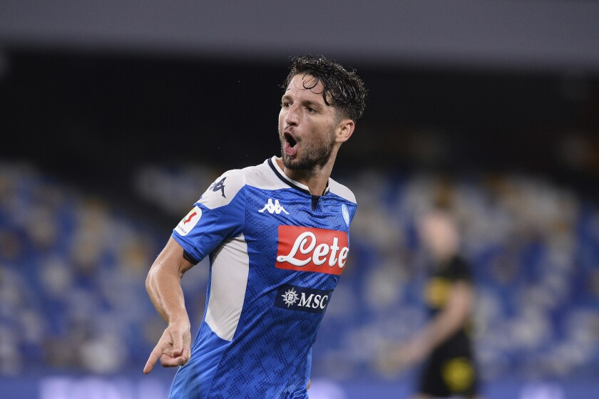 Napoli's Dries Mertens celebrates scoring his side's opening goal during the Italian Cup second leg semifinal soccer match between Napoli and Inter Milan, at the Naples San Paolo Stadium, Italy, Saturday, June 13, 2020. The match is being played without spectators because of the COVID-19 restriction measures. (Cafaro/LaPresse via AP)
