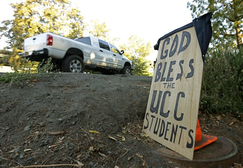 A sign honoring those killed in a fatal shooting at Umpqua Community College, is displayed Friday, Oct. 2, in Roseburg, Oregon.