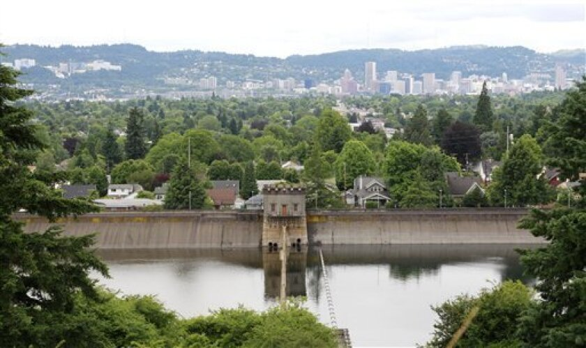 This photo taken June 29, 2011 shows Portland's reservoir No. 6 in Mount Tabor Park in Portland, Ore. If 21-year-old Josh Seater had been holding something more ominous than a full bladder when he stepped up to the wrought iron fence around Reservoir No. 1 in Portland's Mount Tabor Park, he might have done some serious harm. Even before the terror attacks of Sept. 11 2001, some experts on urban waterworks had identified contamination by terrorists as a threat. (AP Photo/Rick Bowmer)